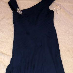 Dark navy long formal dress with broach.